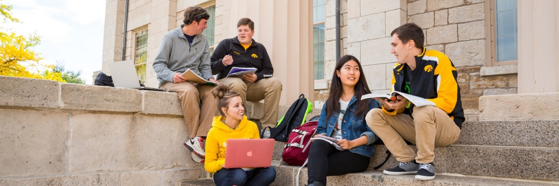 Students studying on steps